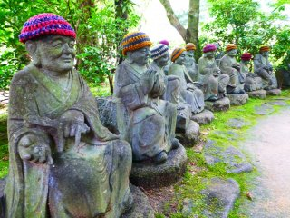 To the left of the steps leading up the temple you will find a path which winds through a multitude of jizo statues