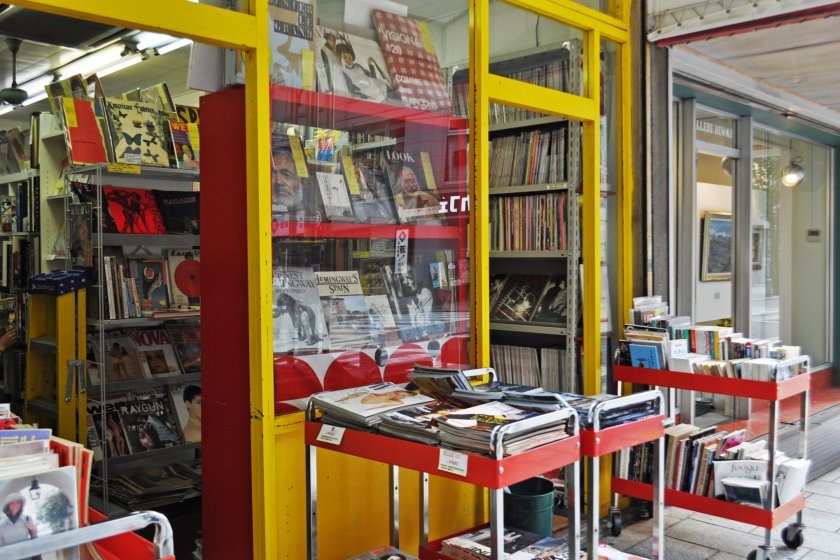 This is Magnif Zinebocho. Look at all those amazing books and magazines.