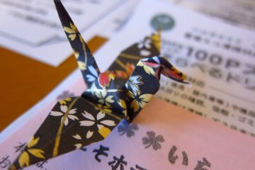 Paper origami crane to greet you in the room