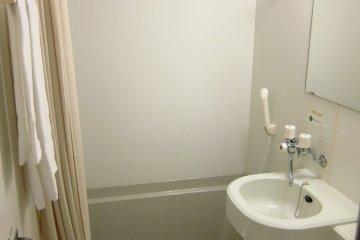 Sparking White Bathroom with Bathtub at Hotel Grantia Akita Spa Resort