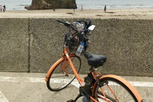 Bright orange bicycles are available for rent at Izumo Taisha Mae Station
