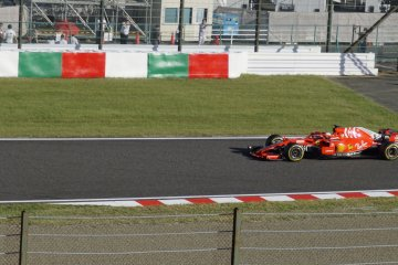 A Ferrari race car passing by to race for the winner of Japanese Grand Prix