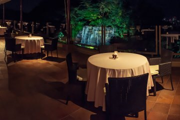 The dining area spreads out on to the balcony, giving amazing views over the large waterfall and Okayama city.