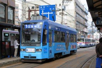 Naik Trem di Nagasaki