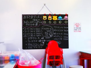 The chalk board advertises the special coffee and sweets menu