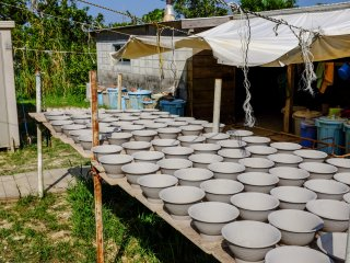 Throughout the village there are pottery bowls drying in the sun