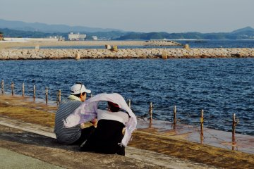 In the last hours of sunlight, people come here to enjoy the ocean breeze.