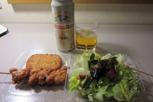 Croquettes, salad and beer bought in a Japanese convenience store, or 'combini'
