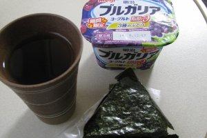 Yogurt and an onigiri rice ball for breakfast