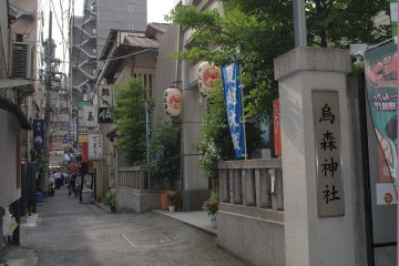 The unassuming sense of the back street leading to the shrine.