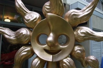 The iconic sun face in the garden