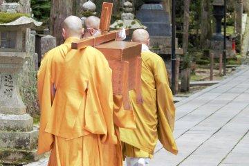 Monks processing through Okuno-in towards the mausoleum
