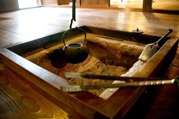 The irori indoor hearth at Ichinoe Nanushi Yashiki