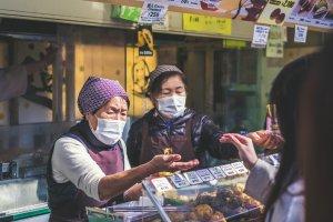 Food handlers often wear masks as a courtesy