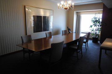 The Imperial Suite room has a dining table