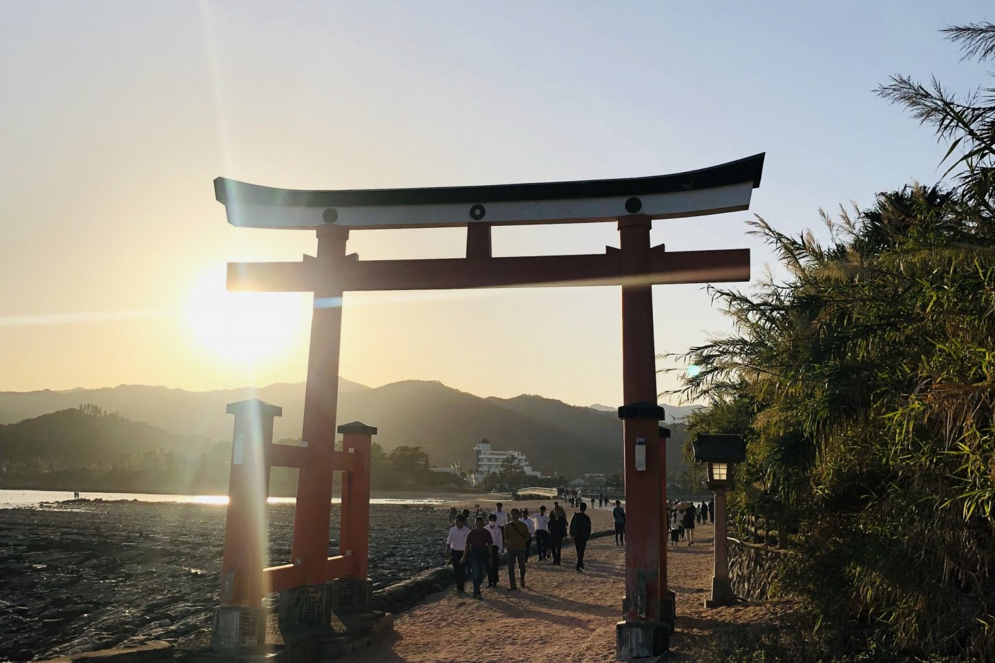 The red torii on the beach leading to the shrine