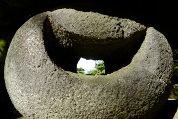 Through the moon-shaped hole in this rock you can see the top of Mount Chokai.