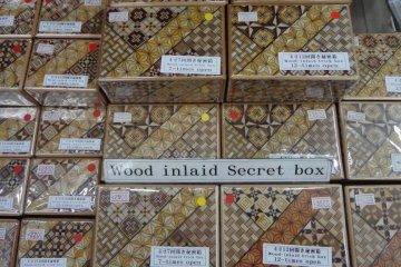 <p>Mosaic work with parquetry-like patterns adorn these boxes. The box itself is a puzzle.</p>