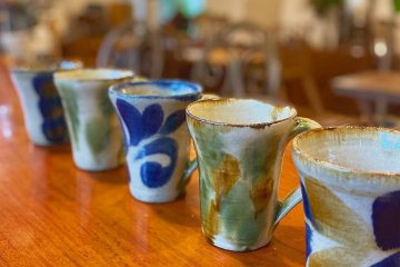 Local pottery is used to serve beverages in