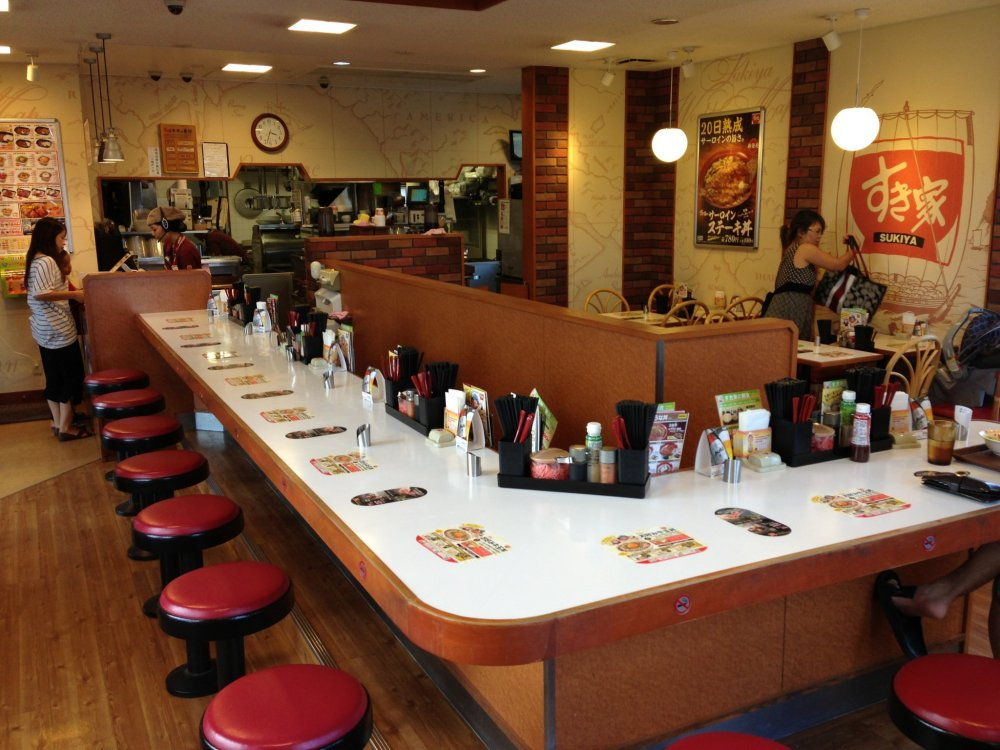 Sukiya locations in Okinawa seem to have the same store layout; there's about eight tables to sit at and a dozen bar stool counter top spots to dine at