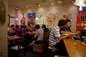 Local and foreign customers all enjoying some hot ramen at Kyoto Ramen Koji on the 10th Floor above Kyoto Station
