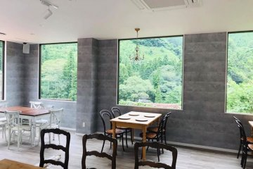 The cafe's large windows open up to the stunning nature outside