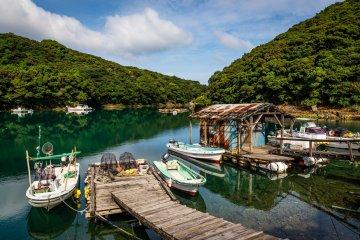A charming clear-watered fishing harbor next to Kiri Church