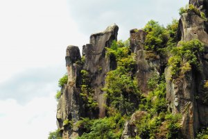 The rock at the very left is called Saru-no-tobi-iwa (monkey jumping on the rocks) and is located right by the minshuku - can you see the monkey's face from the side?