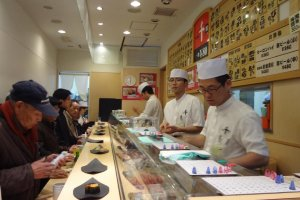 A shop full of happy customers. This sushi is good!