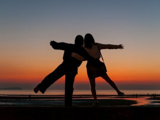 Are they pledging their female friendship in the Seto Inland Sea twilight?