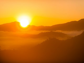 Morning sun shines over the sea of clouds. Emotional scene like this should be captured with backlighting