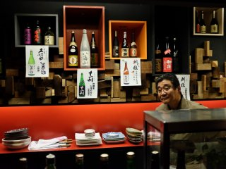 The interior of Ryougoku is simple and beautiful with Sake bottles and traditional Japanese decorations throughout