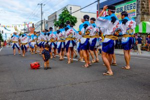 Traditional dancers parade down the street