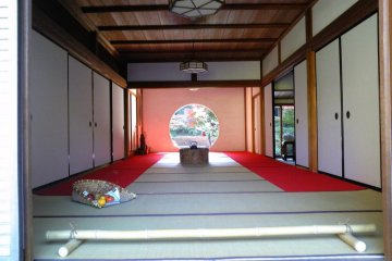 """Inside of Hondou, there is a circle window """"Ensou"""" (円窓). The view through the Enso is a very interesting way to see nature, just like viewing a beautiful painting. Enso works as the frame of the painting and the painting itself changes from season to seas"""