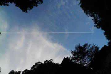 Jet trails across an evening sky.