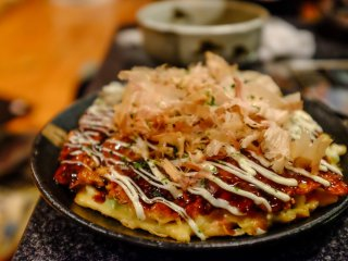 Jyuzo also specialises in okonomiyaki, the chefs prepare it on a giant hotplate right before your eyes