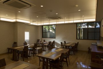 The dining room offers a humble environment while eating with a quaint little garden outside the window