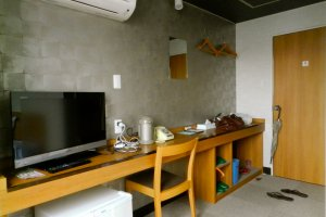 The long desk and genkan.