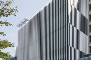 The Suntory Museum of Art has white ceramic accents on the exterior