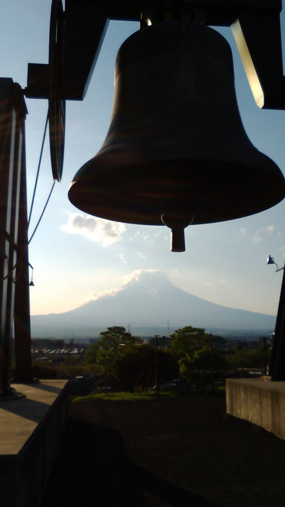 Tokinosumika is home to the third heaviest bell in Japan. You can see Mt Fuji under the bell.