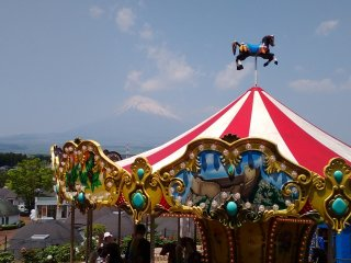The love seat is situated in front of the carousel which also has a view of the mountain.