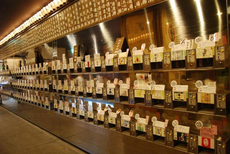 Row of sake mini vending machines at the Ponshukan