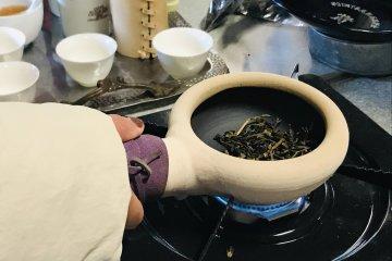 Roasting the tea in the ceramic pot