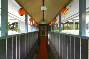 Lanterns line the walkway between buildings.