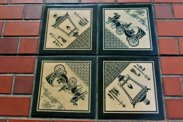 Tiles of gas lamps and horse drawn carriages on the Bashamichi avenue