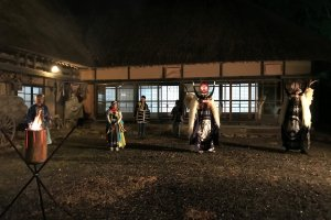 Experience the local Shishi Dance outside an old farmhouse by night.