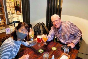 Rey and Miwa enjoying a Nest Beer at Mito Station
