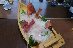 Fresh sashimi served in a traditional and elaborate sashimi boat.