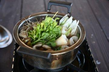 Nabekko hot pot with kiritanpo simmering alongside the veggies