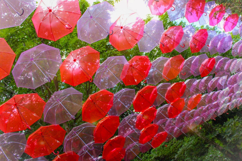 Red umbrellas at Metsa